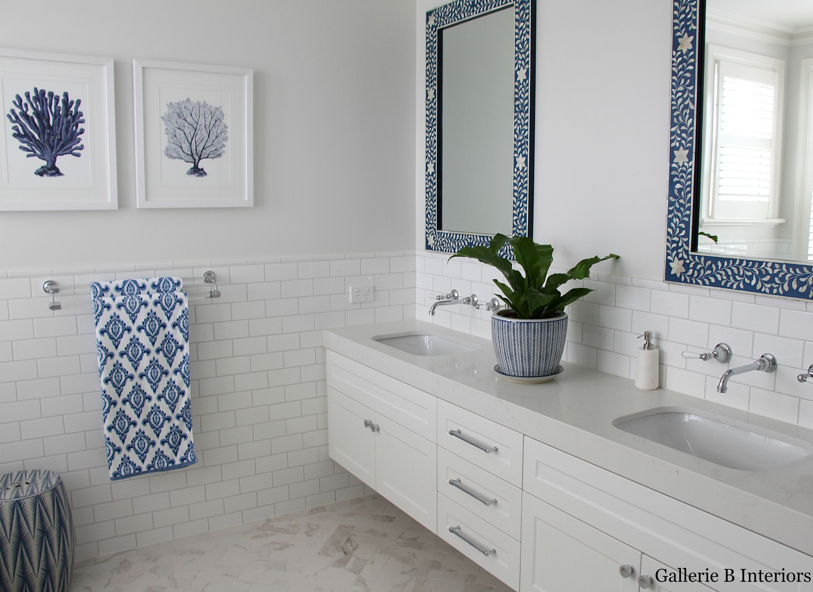 Classic Hamptons style blue and white bathroom with bone ...