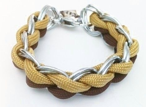 This bracelet is weaved  through a double linked silver chain with 550 Type III Paracord and closed off with a silver buckle clasp to give you that classy finishing touch.
