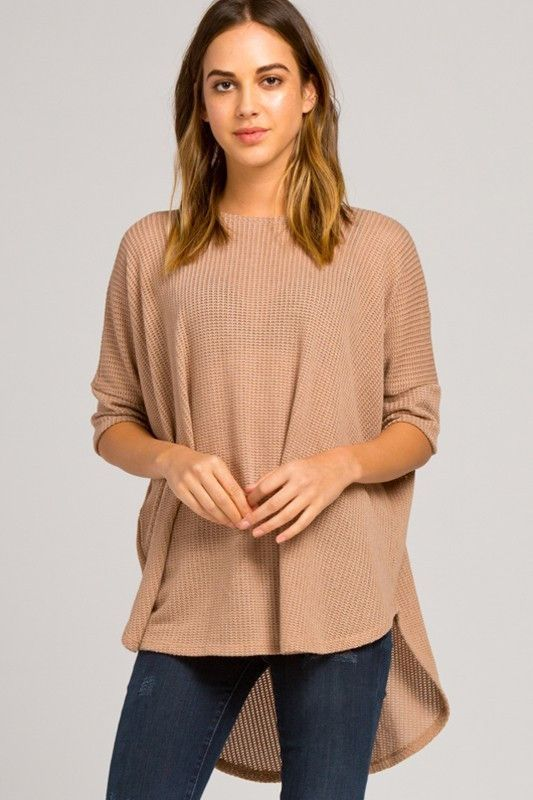 T14557A Loose fit, elbow length dolman sleeves, scoop round neck, hi low top. Rounded hems. Has sleeve bands. Has center back seam. This top is made with low gage sweater knit fabric that is of medium