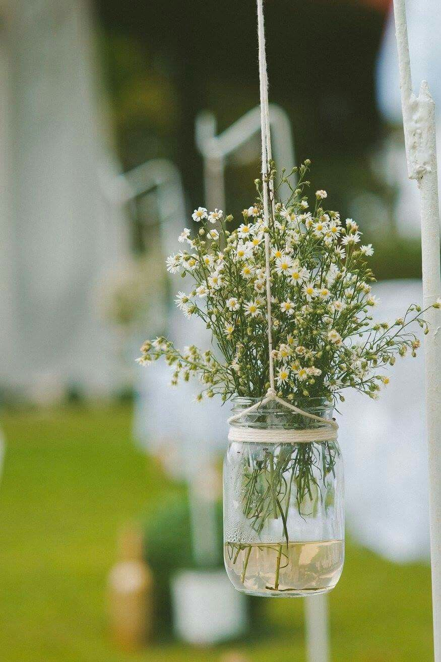 I ooter for a simple aisle decoration. A hanging mason jar with ...