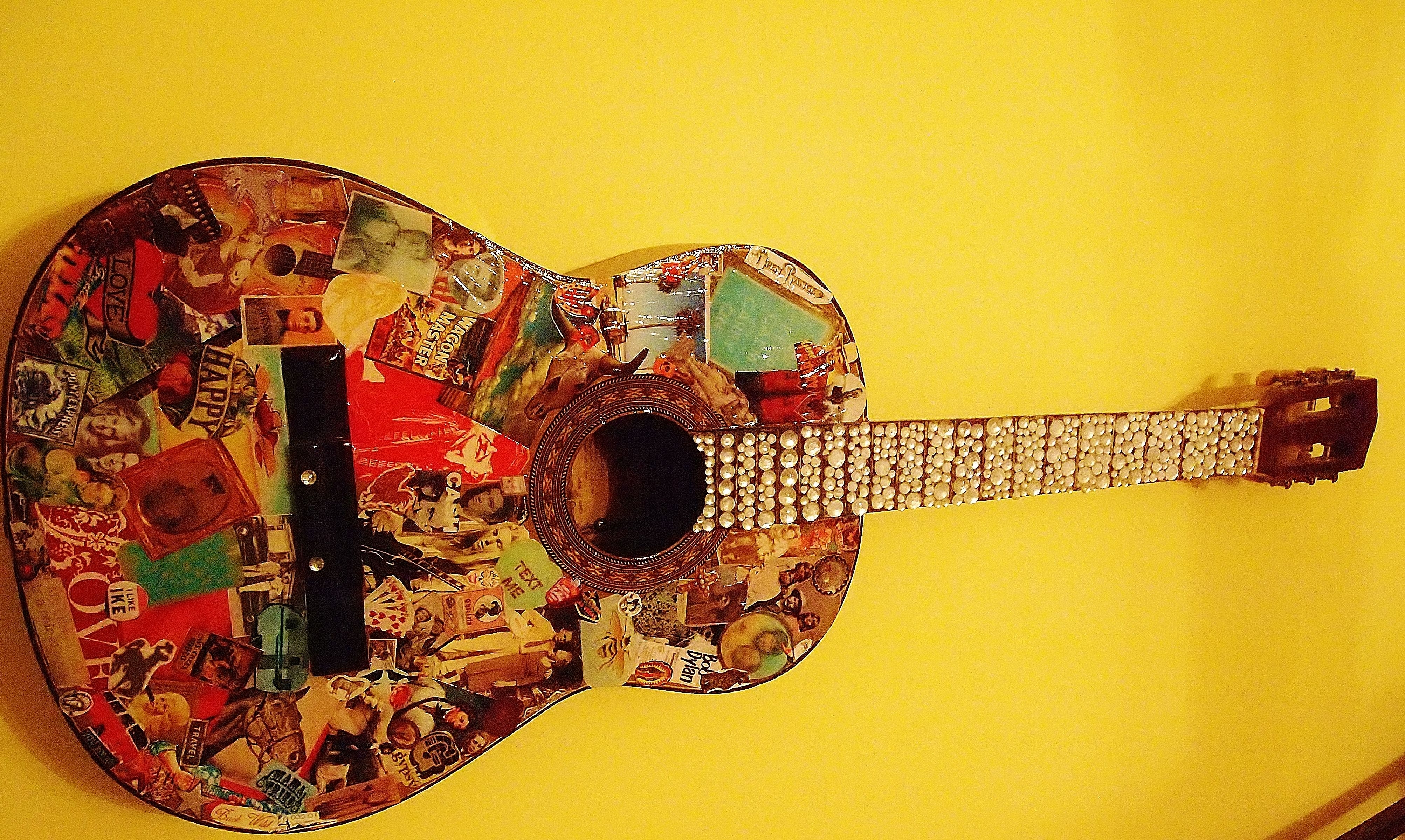 Old guitar + cool pictures + rhinestones = awesome DIY wall decor ...
