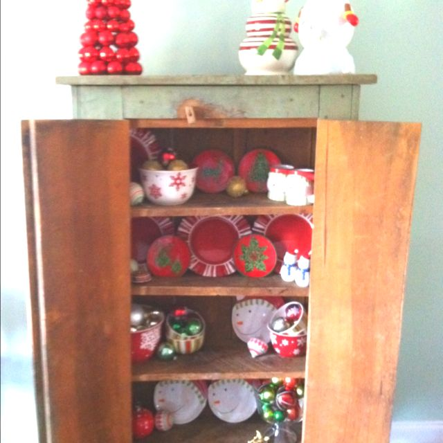 I change out my regular dish display to display my Christmas dishes. And I mix in a few ornaments, of course.