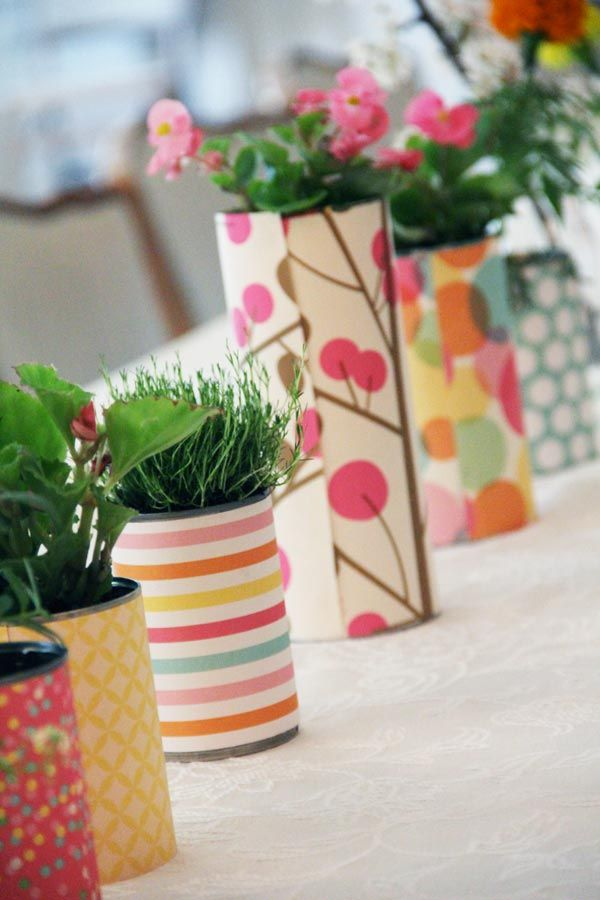 Cans covered in paper, make pretty flowerpots. So Smart and thrifty!