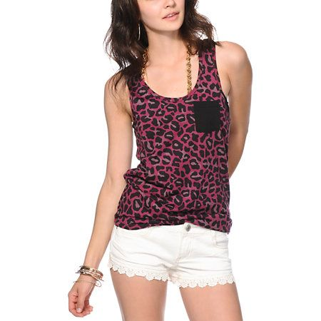 a86e3c98f Look as good as you feel with the solid chest pocket that contrasts the  allover leopard print on this relaxed fit racerback tank top.