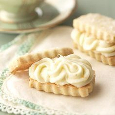 Vanilla Bean Shortbread Sandwiches with Orange Buttercream - Make the vanilla-flavored shortbread in advance and store them in the freezer. Then when you're ready to present them, add the fresh orange frosting to make an elegant sandwich cookie,,