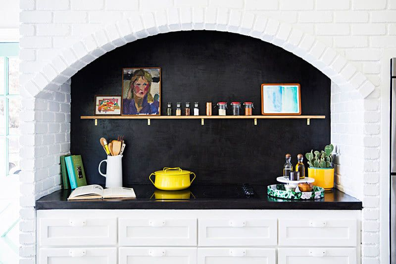 White Kitchen Cabinets With Black Countertops Are The Next Big Reno Trend Black Countertops Southwestern Home Countertops