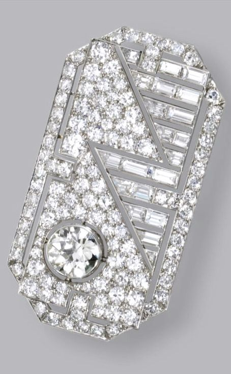 DIAMOND BRACELET, CIRCA 1930 The flexible band composed of three articulated openwork plaques, set in the center with 3 old European-cut diamonds weighing approximately 2.10 carats, connected by stylized links, set throughout with numerous old European-cut and single-cut diamonds weighing approximately 27.00 carats, mounted in platinum, length 7 3/8 inches.
