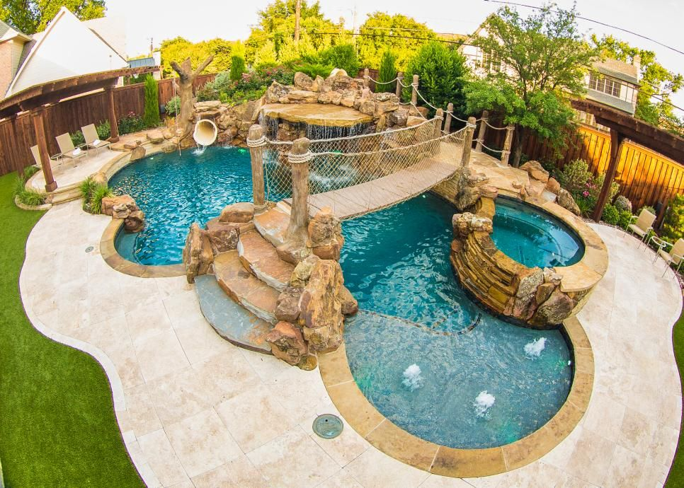 Organically Shaped Pool With Suspended Bridge In Tropical Backyard Dream Pools Backyard Pool Tropical Backyard