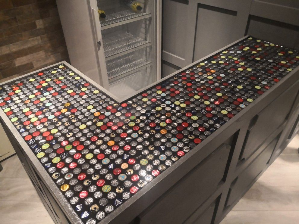 epoxy resin bar top with bottle caps. base built out of ...