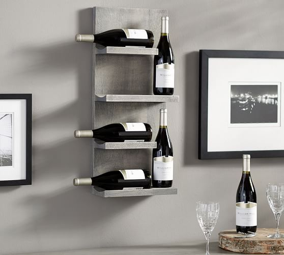 Looking to expand the storage of your home bar? This wall-mounted rack holds six bottles in a clever, narrow design. Perfect small space solution in a kitchen or dining room!