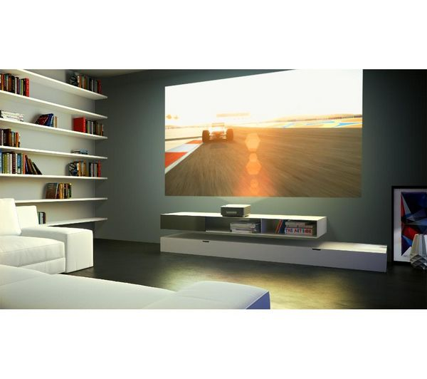 Projector that sits next to wall, integrated speakers (10w), is portable and looks amazing!!!  Buy PHILIPS Screeneo PHD 1590TV HD 3D Projector | Free Delivery | Currys