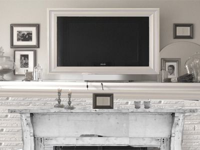 mounted tv frame over fireplace white