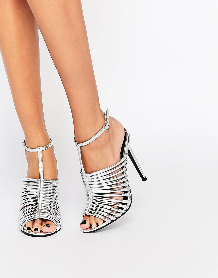 9cd43dd4202 Kick up those strappy silver heels.