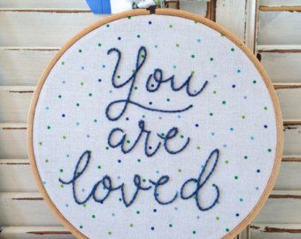 YOU ARE MY SUNSHINE HAND EMBROIDERED HOOP ART  • 7 wood embroidery hoop • Cotton fabric • Sunshine yellow cotton floss  A true classic ...  I have many beautiful fabrics & flosses in house that can be used to create your perfect personalized piece - so please feel free to send me a convo :)  Display alone on a wall, table or shelf or in a grouping on a gallery wall in your little ones room. You will find many other pieces in my shop that would pair well with this listing - so be sure to l...