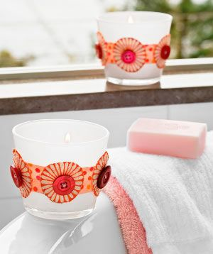 Using buttons to decorate votive andle holders - as seen on Better Homes and Gardens