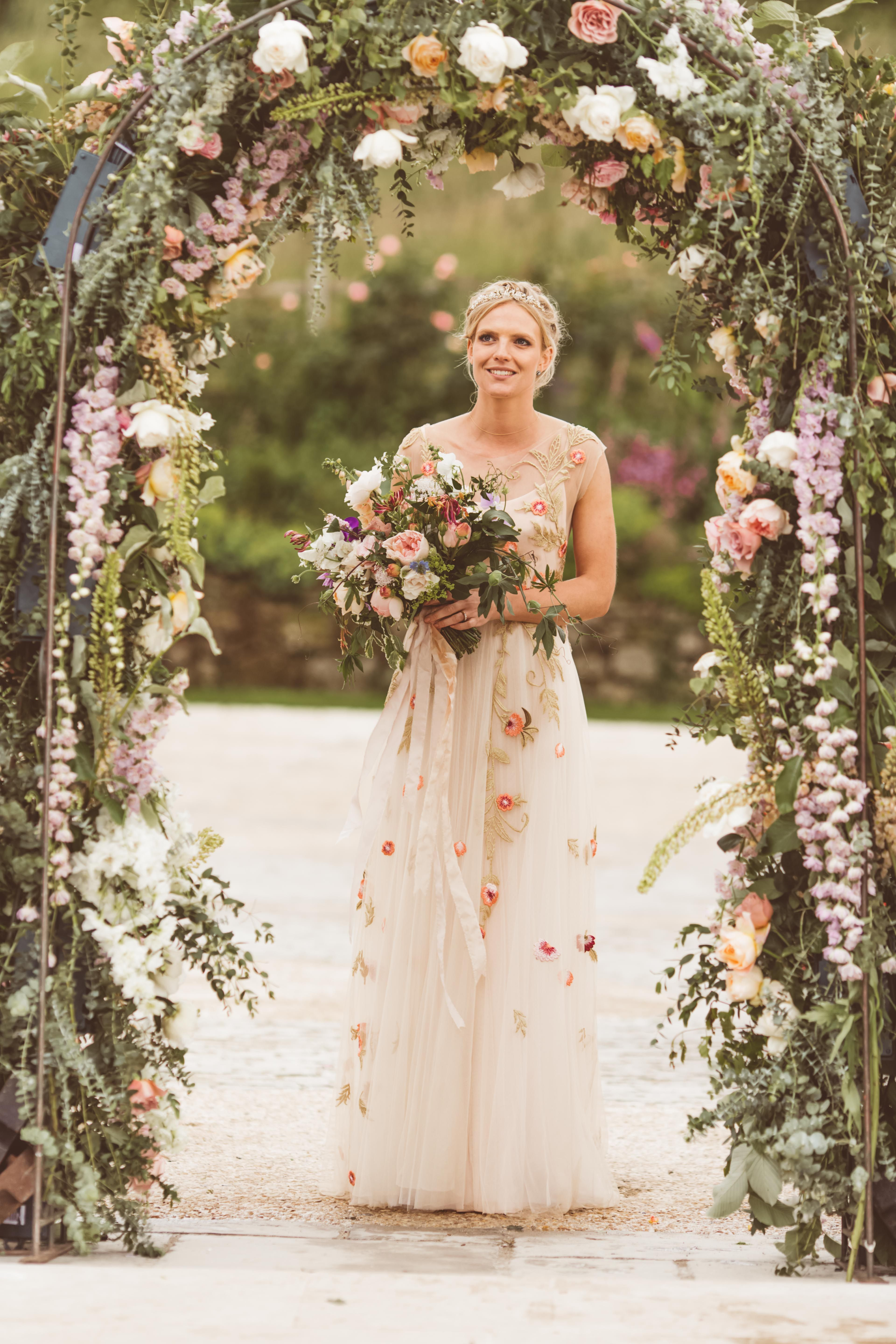 Gorgeous Picture Of One Of Our Brides In Her Festival Flowery Wedding Dress Weddingdressideas Floweryweddingdre Flowery Wedding Dress Wedding Dresses Bride