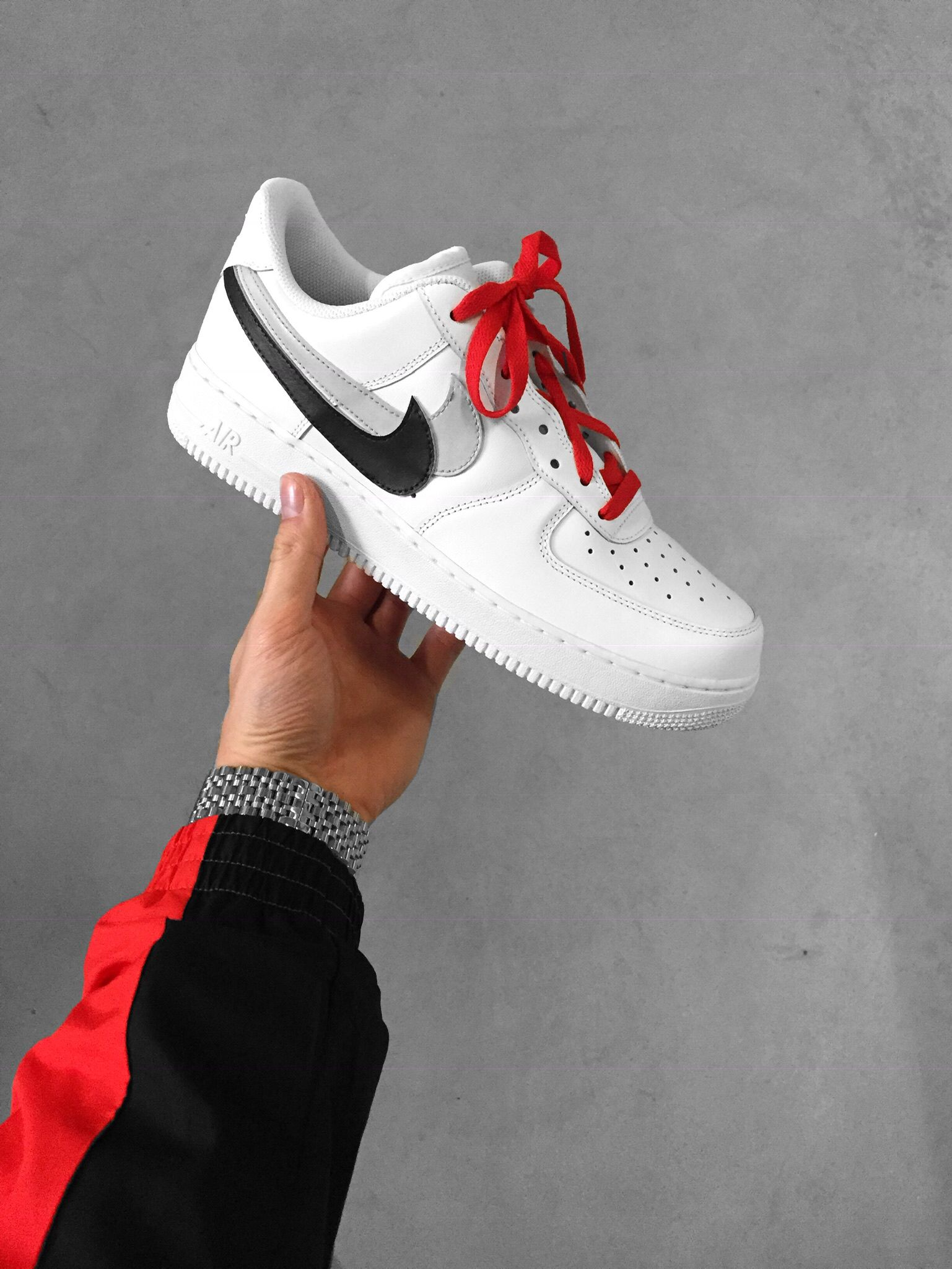 half off 8714e e80b8 This timeless Nike Air Force 1 Low Top Sneaker features two hand-painted  swoosh s, the inner swoosh is cut off and glued on the outside to create  the