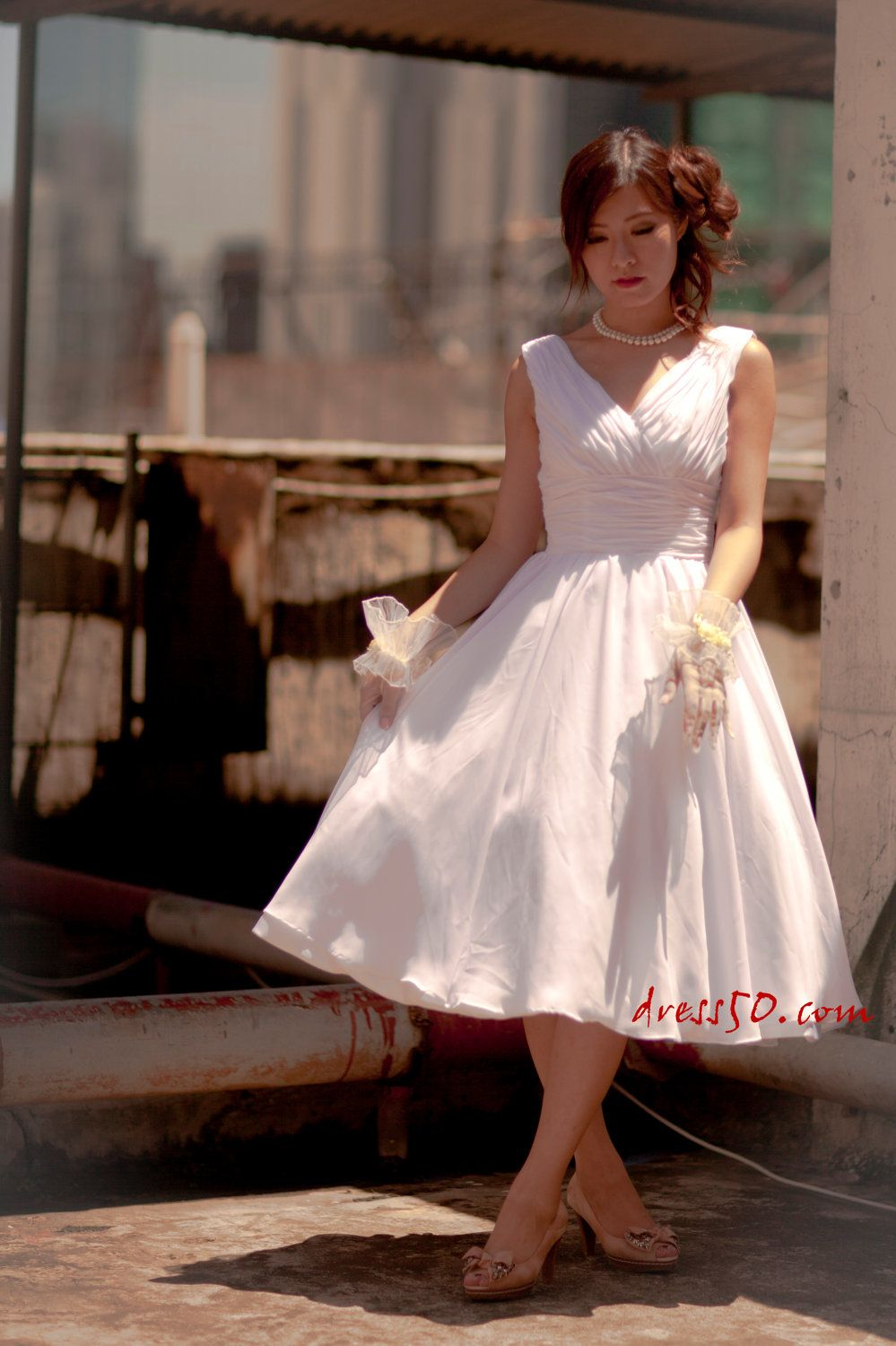 Ready to ship Sample--  50's inspired Vneckline  chiffon  tea length wedding dress. $180,00, via Etsy.