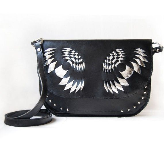 love these combo of black, silver, leather and owl eyes!