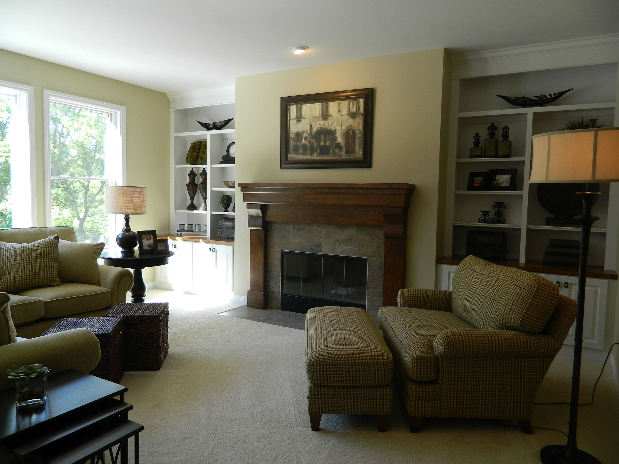 carpet flooring stained fireplace mantel with ceramic tile
