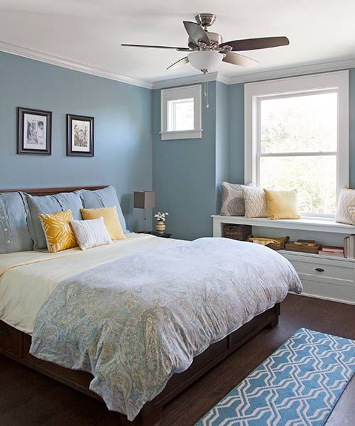 light blue master bedroom with a window seat with storage below