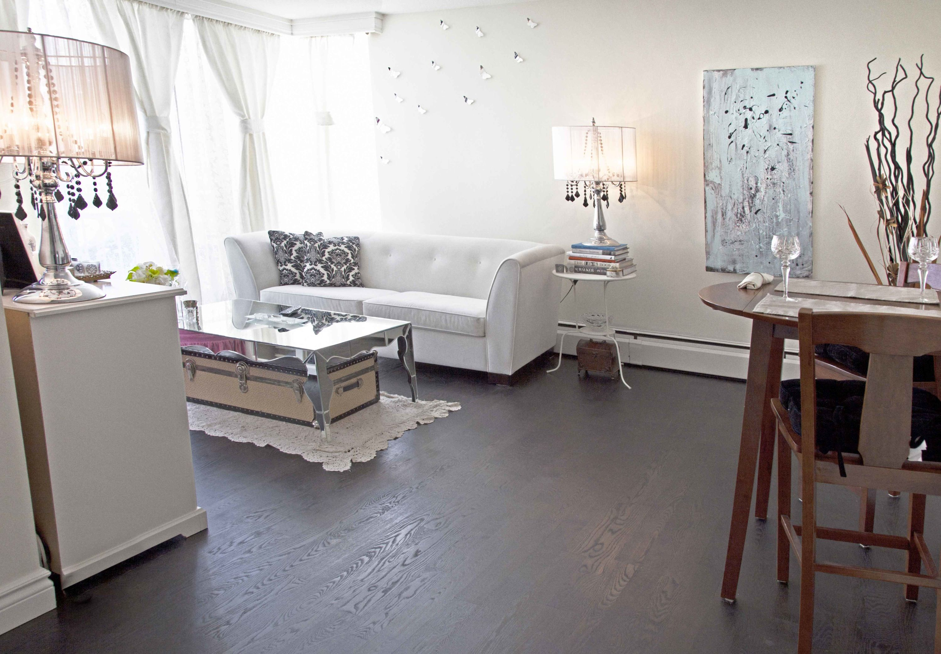 Dark oak floors w/ white sofa Living room furniture