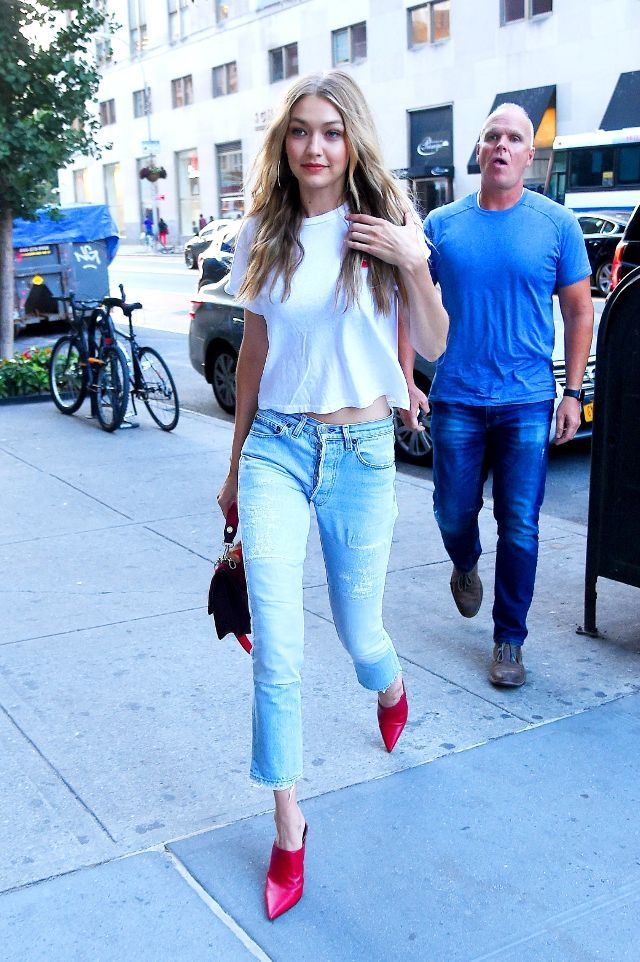 45eb6d550d9264 Gigi Hadid in New York City wearing jeans and red mules.