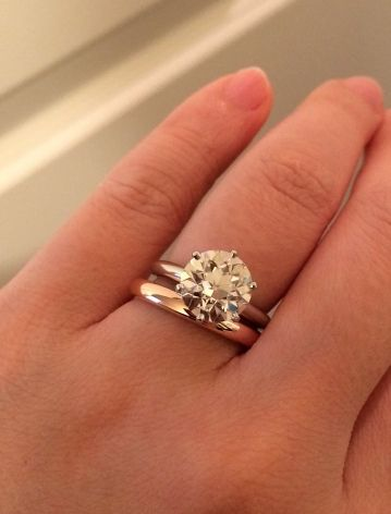 Love Mixed Metals This Solitaire Engagement Ring Is Stunning Next To A Plain Wedding Band
