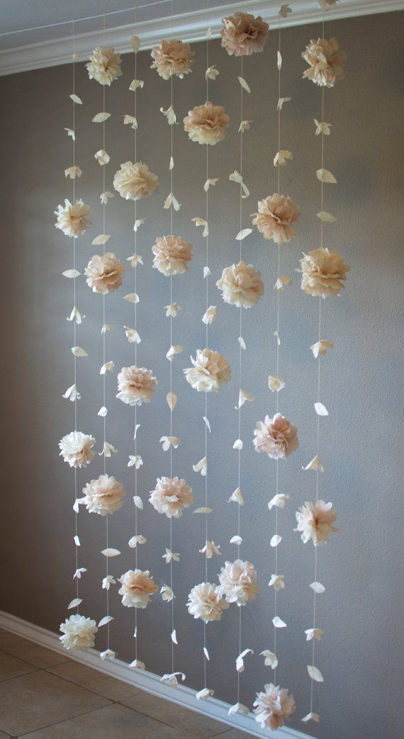 Photo of Paper flower and tissue paper puff garland – do it yourself decoration