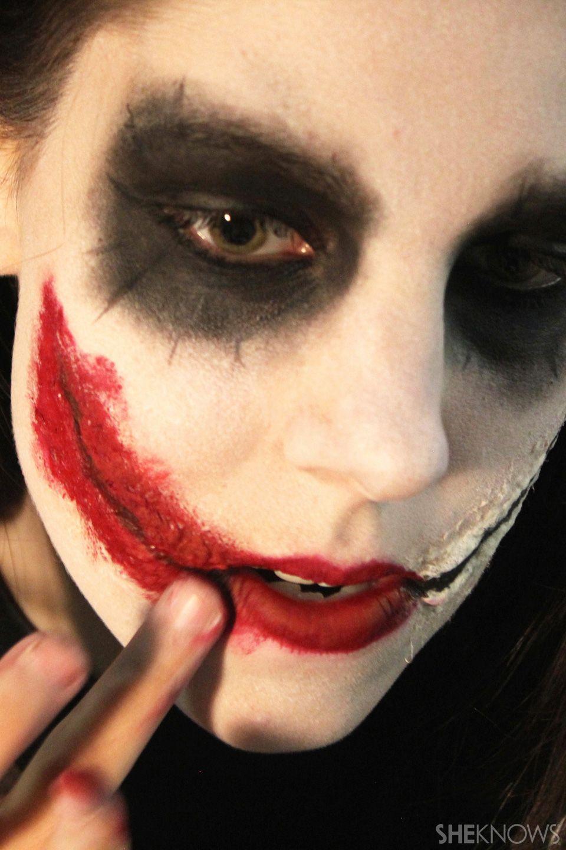 makeup artist demonstrates freaky halloween makeup tutorial