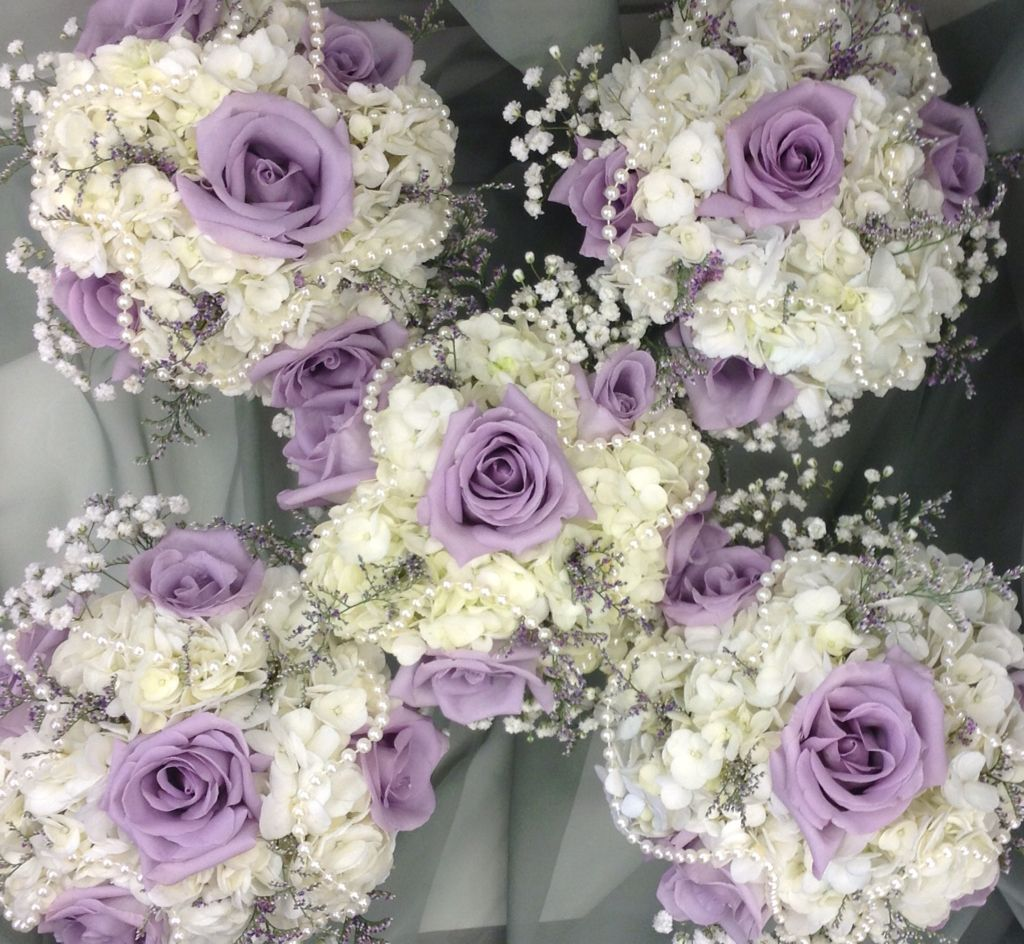 Lavender And White Bridesmaid S Bouquets With Hydrangea Roses Babies Breath And Pearl Accen Purple Wedding Bouquets Bridesmaid Bouquet White Wedding Bouquets