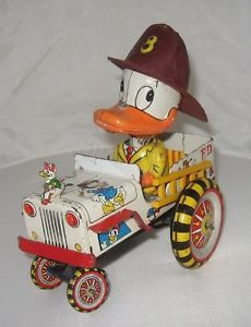 Donald Duck in fire engine, without box, 354,64 € (03/02/14, front wheels to be reattached, reproduction hat)
