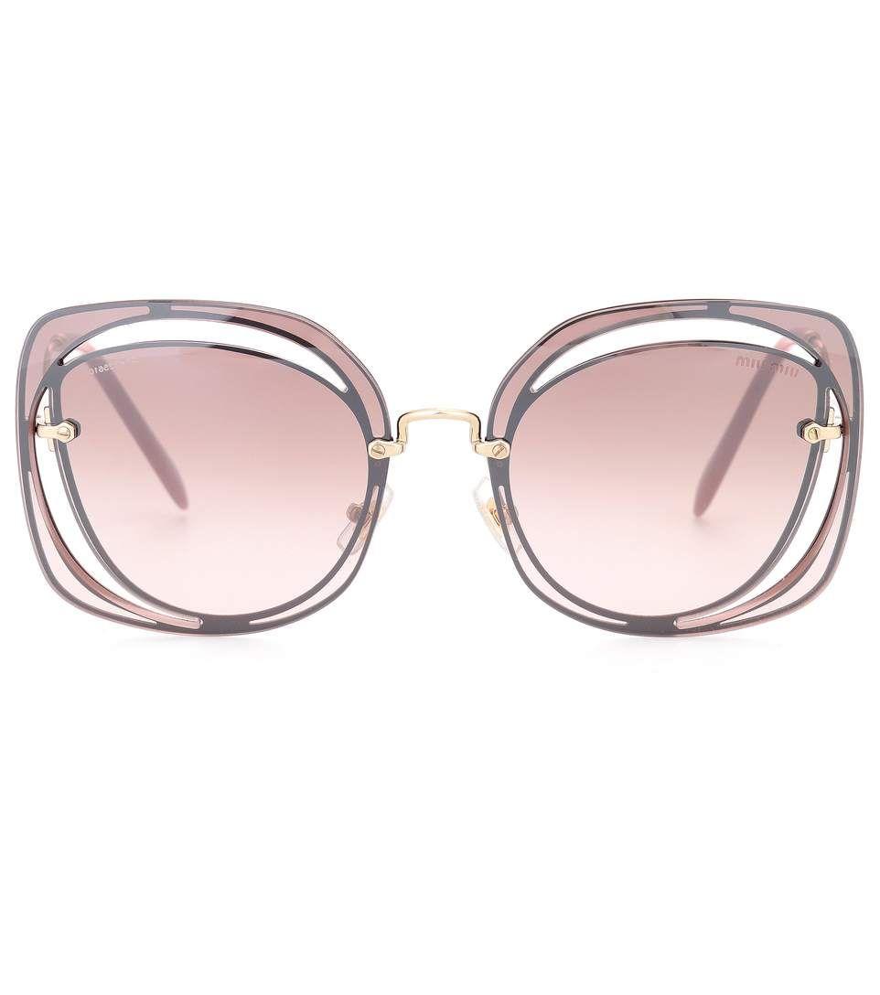 2f5c4ac689e9e MIU MIU Cut-Out Sunglasses.  miumiu  sunglasses