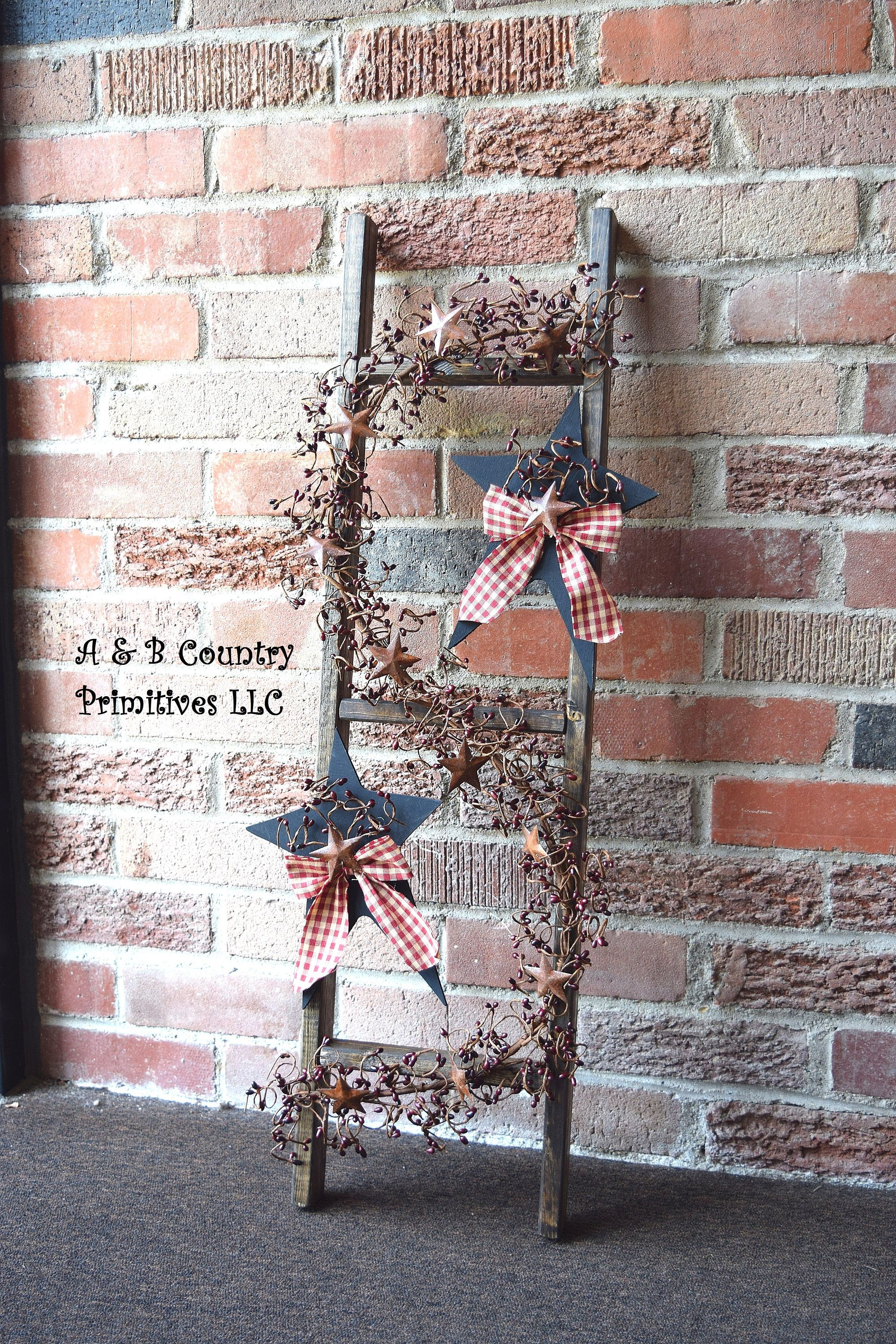 Country primitive ladder with berry garland and decorated wooden