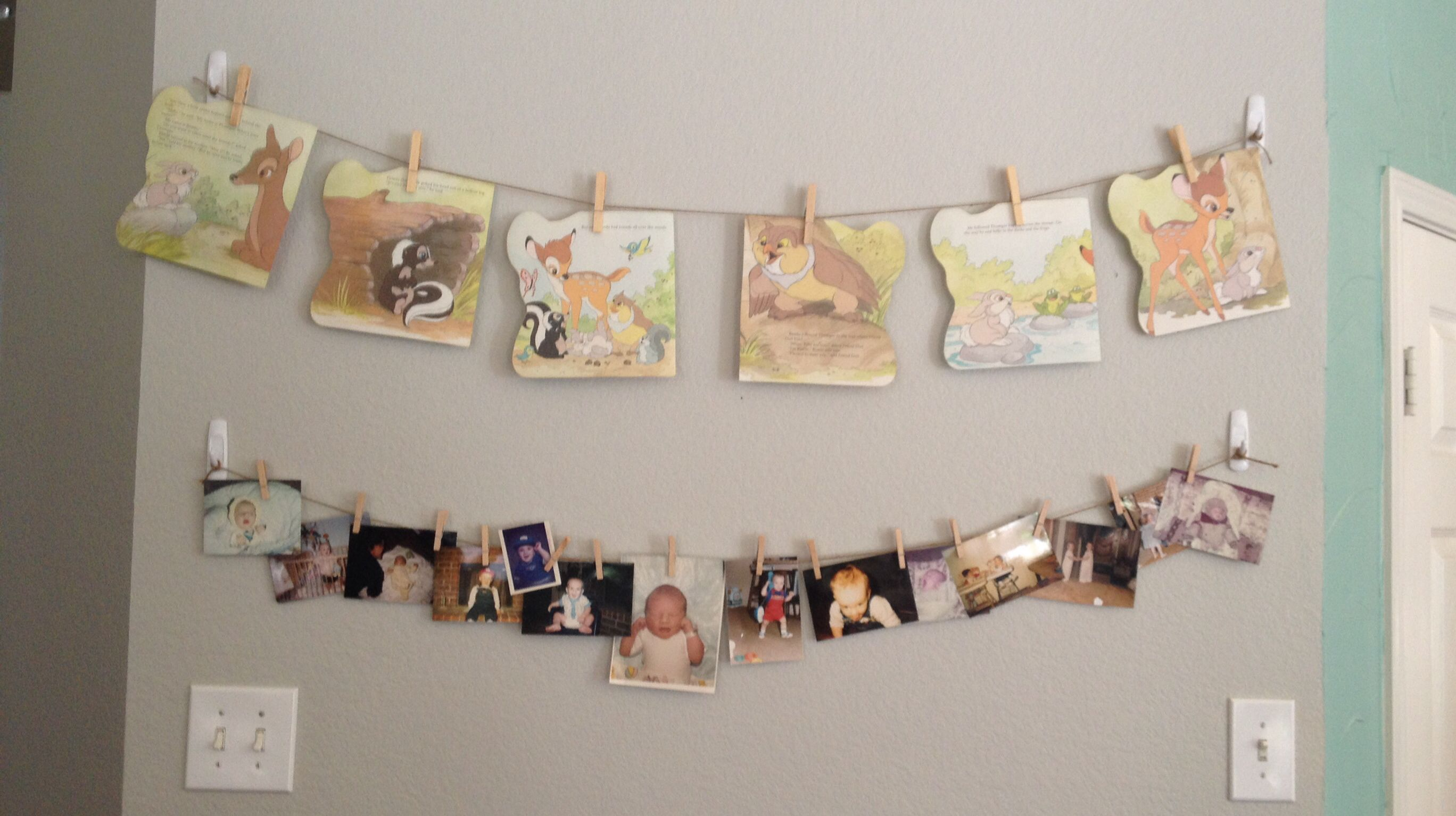 Bambi storybook pages and baby photos hung on twine with mini clothespins