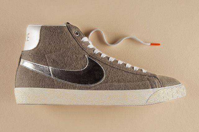 Nike has given the classic Nike Blazer Mid Vintage a makeover with felt for this latest Quickstrike release. The shoe features a felt upper in granite, along with a bright metallic silver Swoosh and a white pearlescent leather heel tab. The midsole has been given a yellowed vintage effect laces feature orange tips to cap it off.