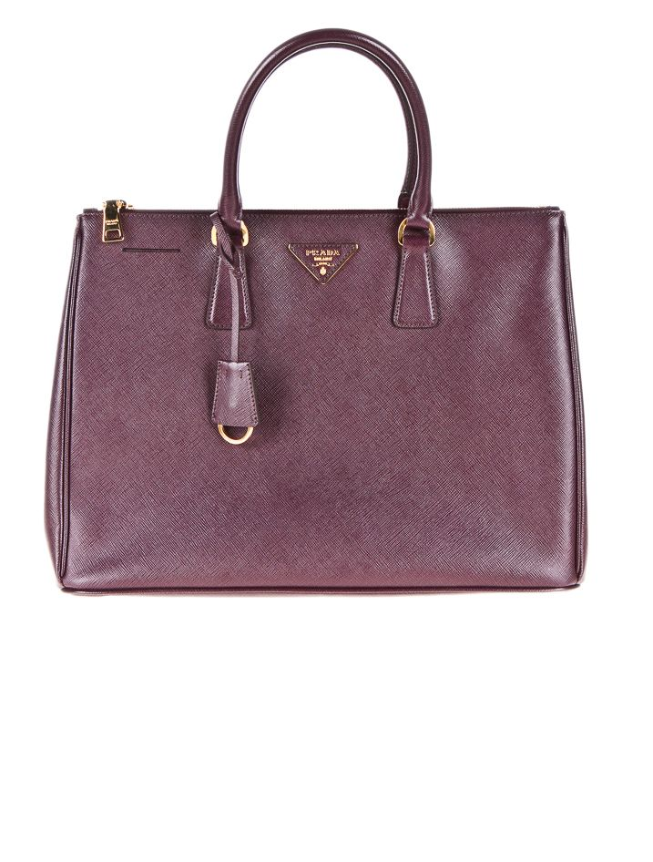 Prada Saffiano Tote also the same bag that was on Mission Impossible 4: Ghost Protocol. Sigh...one day :|