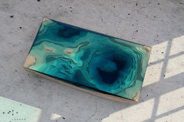 A Dramatic Coffee Table Tells A Greater Story - De