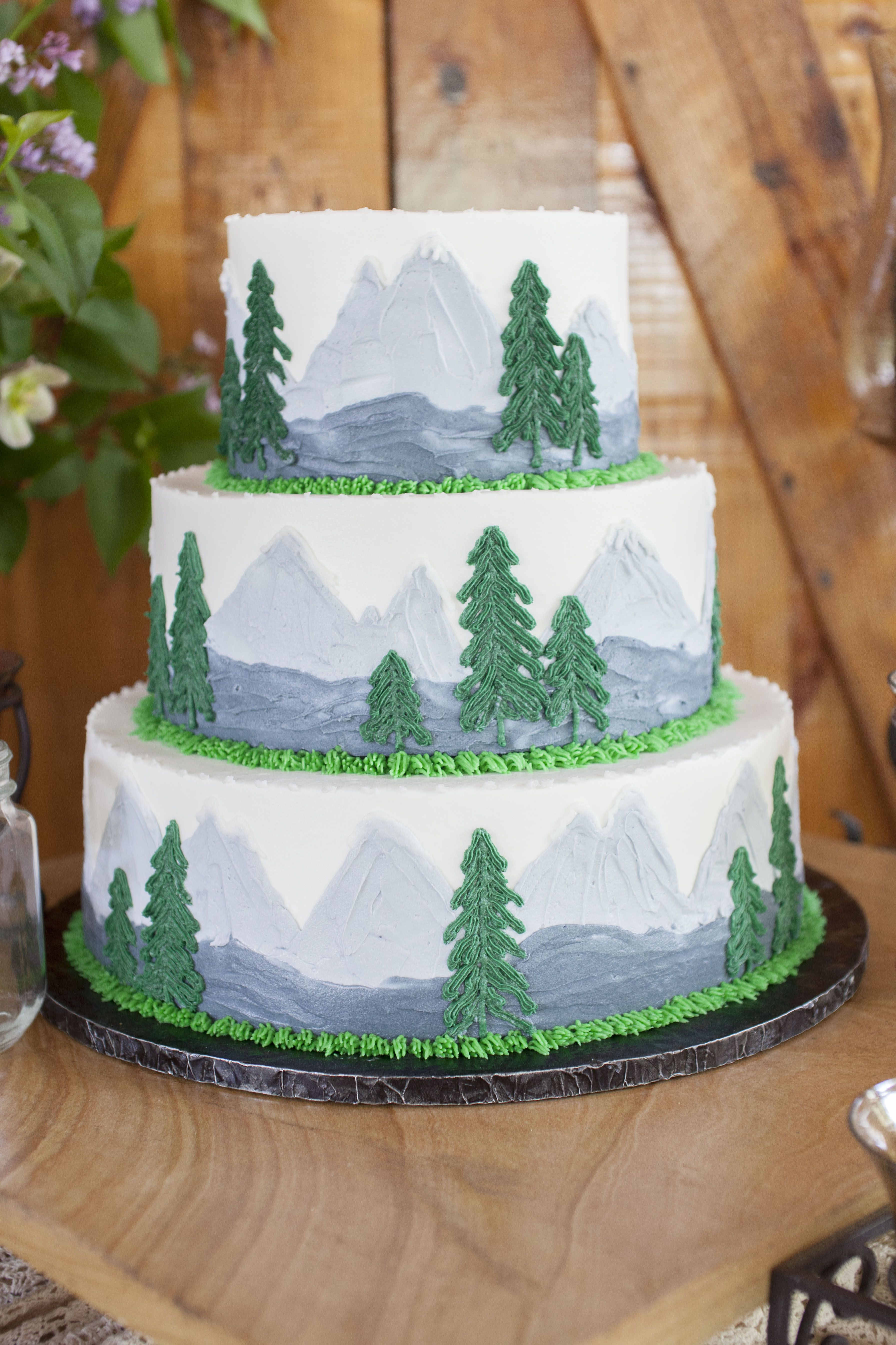 Mountain themed wedding cake with green and gray colors