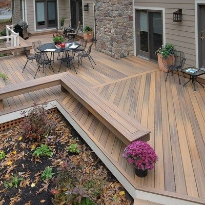 This Ground Level Deck Has A Symmetrical Look With On One Side A Railing And And Both Sides Benches Wrap Ar Deck Designs Backyard Decks Backyard Backyard Patio
