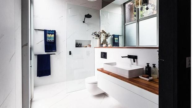 white - inset shelves,floating basin on timber with some closed storage underneath
