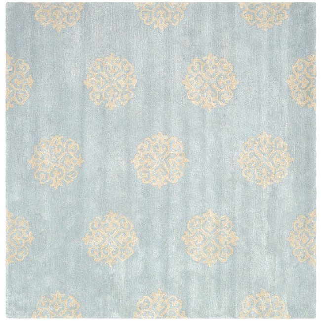 This floor rug has a light blue background and displays stunning panel colors of cream and light blue.