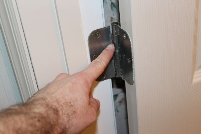 Fix A Door That Closes Or Opens By Itself Home Repairs Doors Homeowner