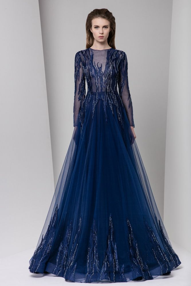 94da8b62c30cc Long sleeve midnight blue A-line tulle evening dress with cascading silk  embroidery on a sheer bodice and hemline.
