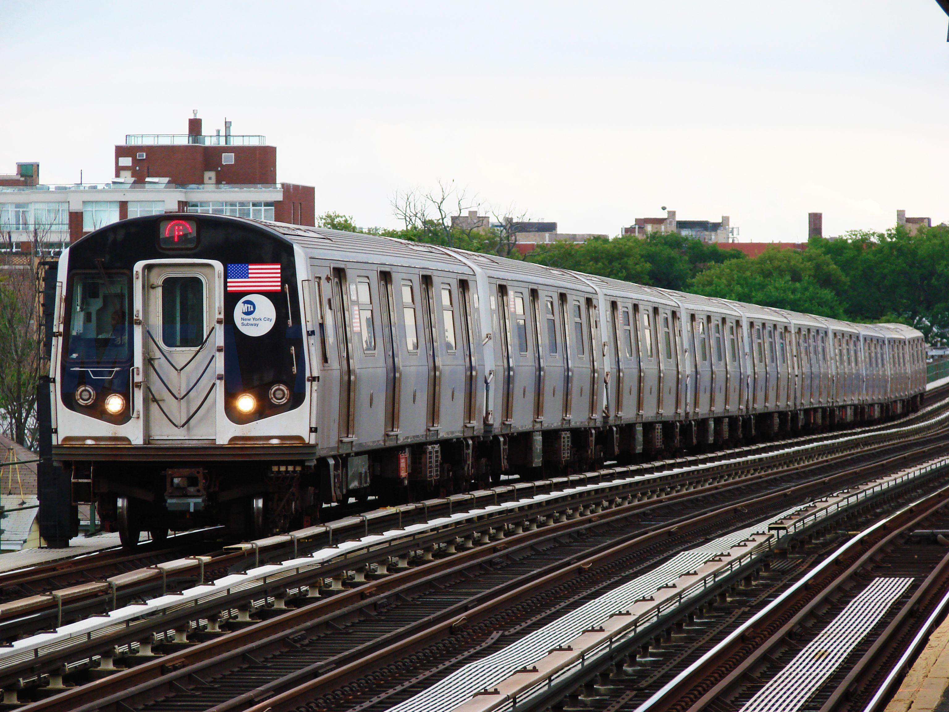MTA NYC Subway F train arriving at Avenue P Subway
