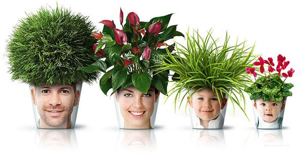 Just decoupage a print out of a face to a pot and add a plant!  Too fun!