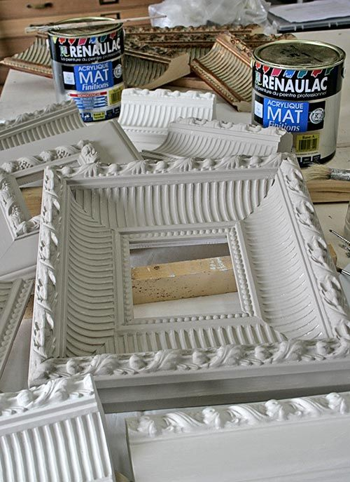 Moulding to frames.  Great way to get awesome chunky frames, which are hard to find when thrifting.