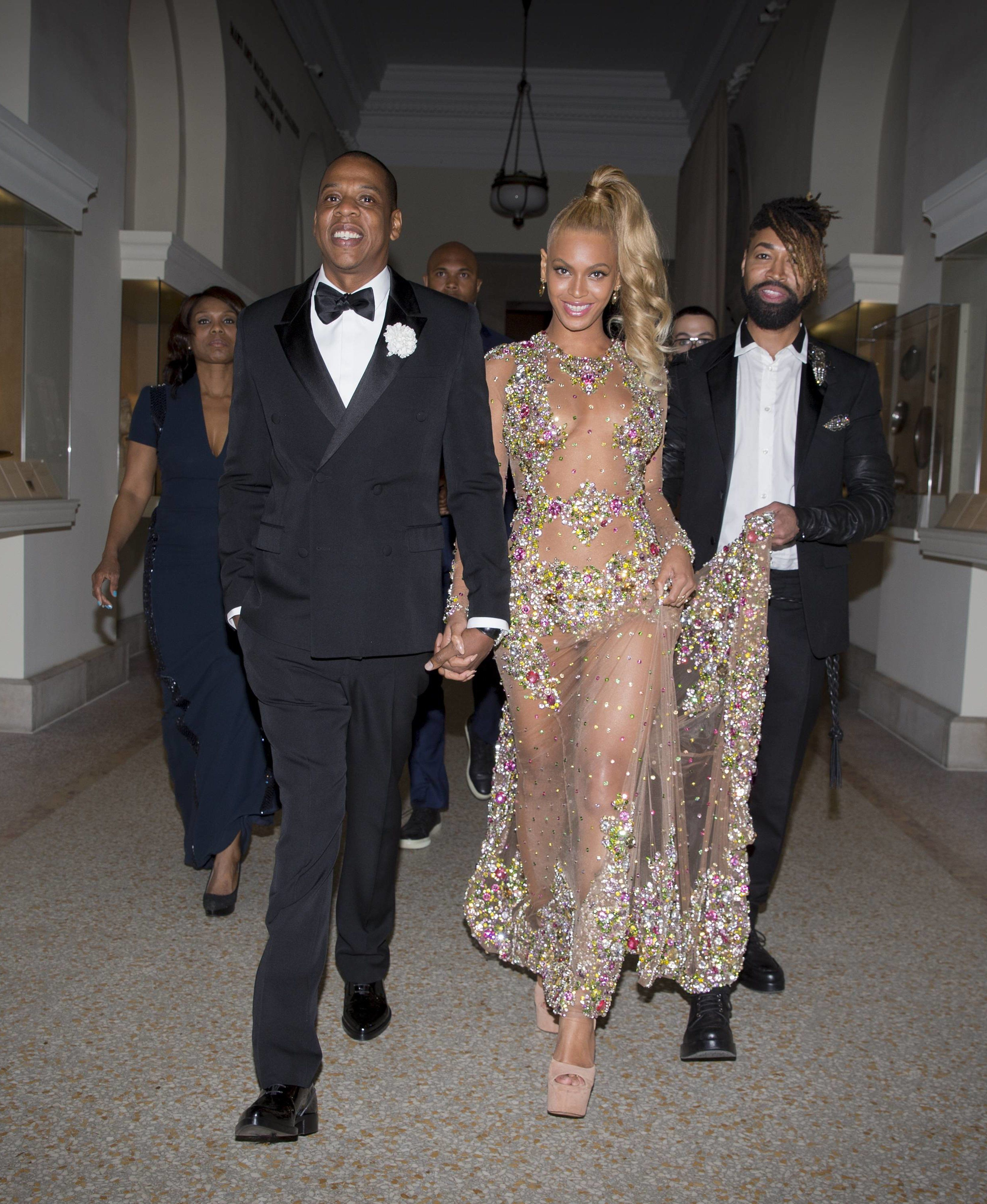 5b98f21e358 Jay Z and Beyoncé in Givenchy with stylist/train holder Ty Hunter,  publicist Yvette Noel Schure and bodyguard in tow