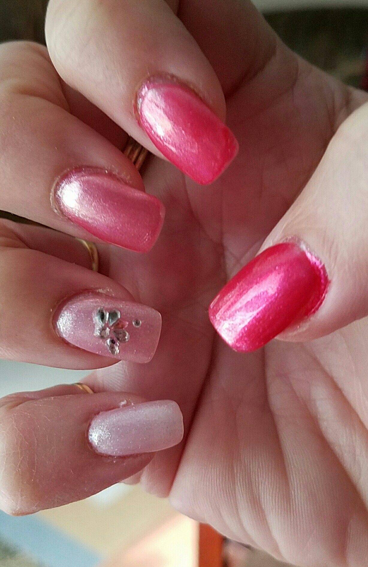 Gradient ombre nails,  manicure in shades of pink for October Breast Cancer Awareness month.