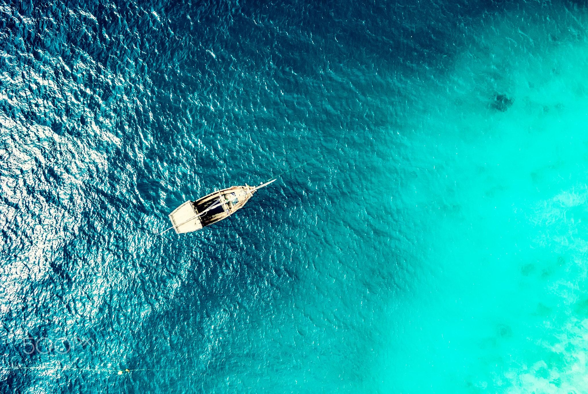 turquoise ocean water with boat on it top view - beautiful ...